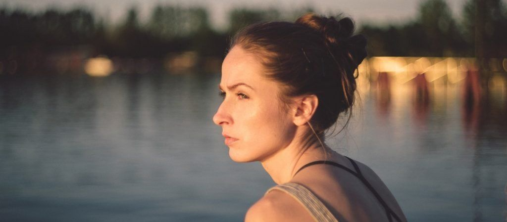 Woman on lake looking off into the distance