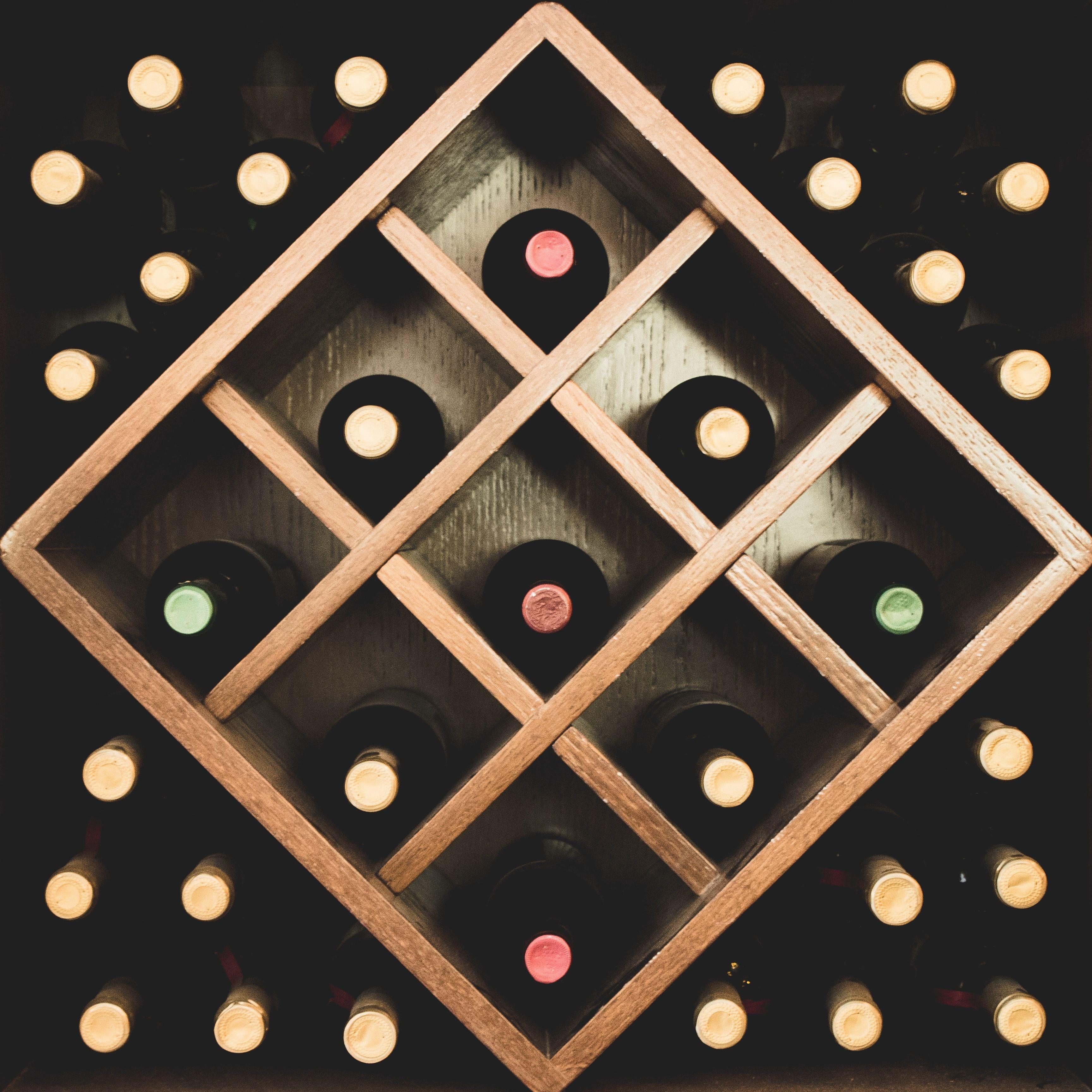 Wine bottles in wooden storage container