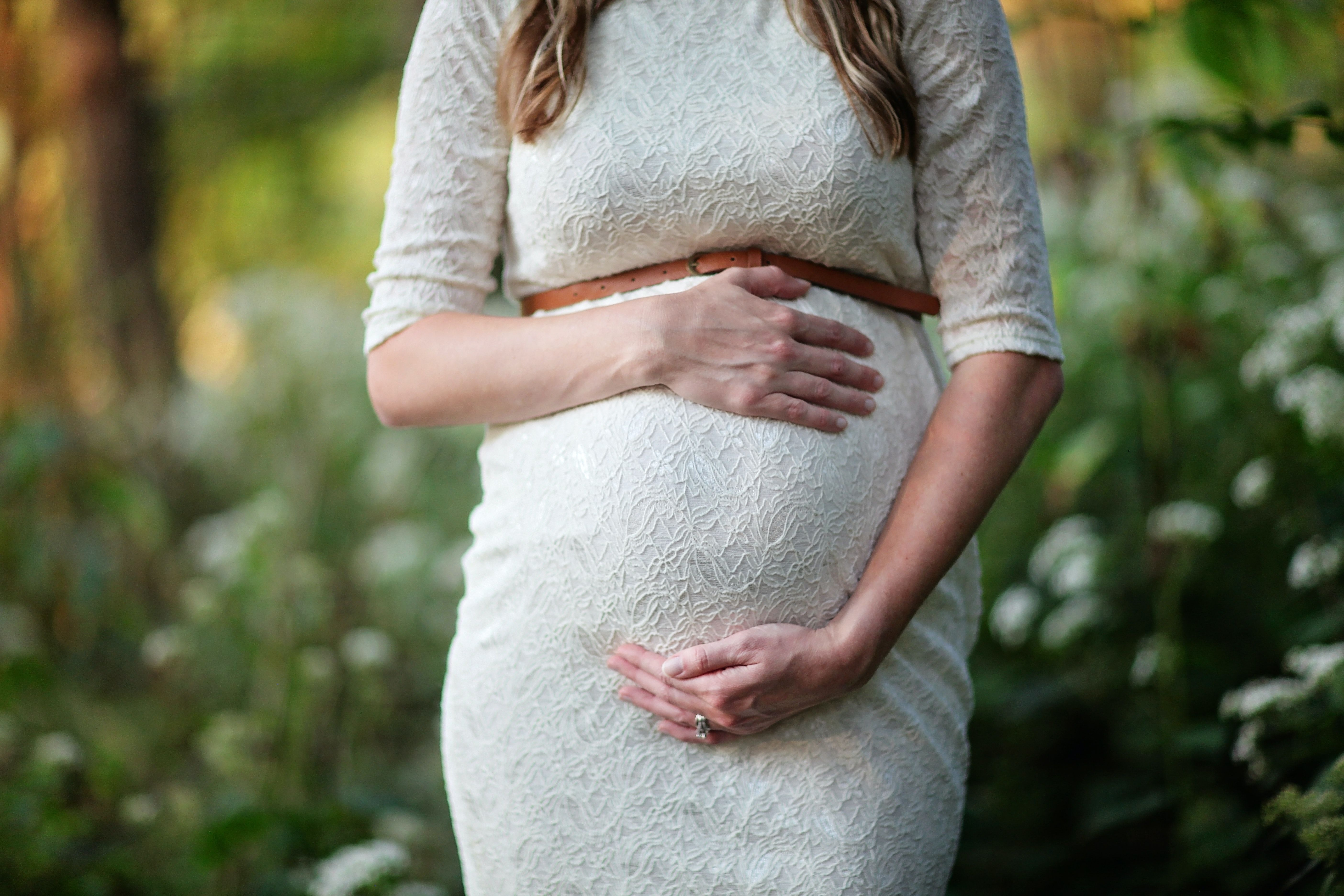 Woman holding her pregnant belly