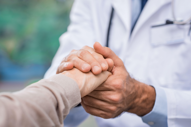 Doctor reassuring patient