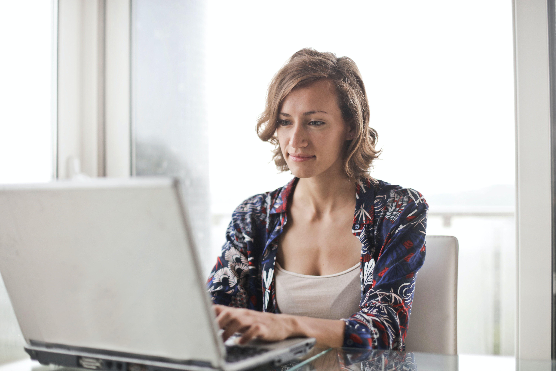 Woman on laptop typing